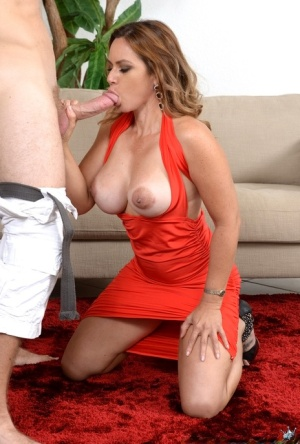Fully clothed MILF shows huge tits in the car  gives hot blowjob