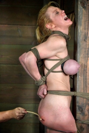 Busty female slave Darling got tied up and tortured by a dominant couple