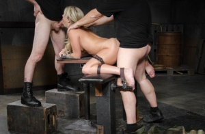 Blond female Madelyn Monroe has a cock shoved down her throat in bondage