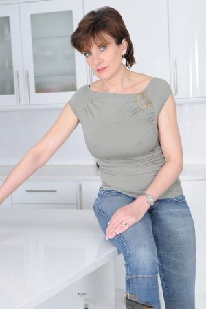 Mature wife Lady Sonia flaunts big tits braless in t-shirt in the kitchen 52925925