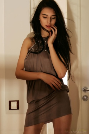 Fully clothed brunette Alice E strips mini dress to display pierced tits