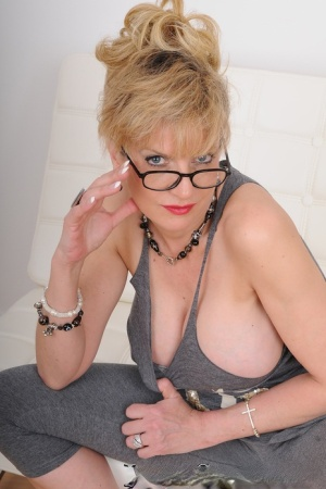 Clothed older woman Lady Sonia teases in yoga wear and glasses