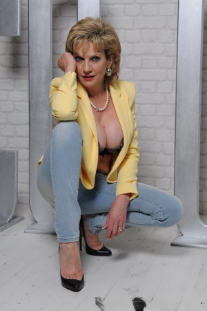 Classy older lady Lady Sonia uncovers her big tits prior to removing her jeans 81678640