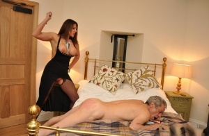 Mistress Carly beats her male slaves ass with crop and makes him eat her out