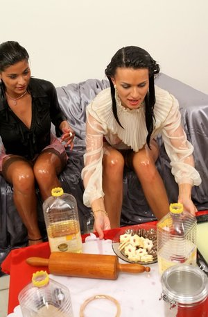 Clothed women end up dousing themselves in liquid after a spill on red skirt