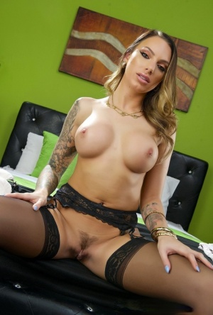 Tattooed slut Juelz Ventura offers huge big tits while spreading in stockings 41273482