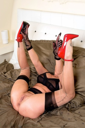 Classy female Amazing Astrid shows off her twat in back seam nylons and heels 75158336