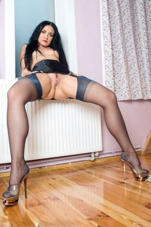 Dark haired fet model Amazing Astrid inserting sex toy wearing black nylons 79725364