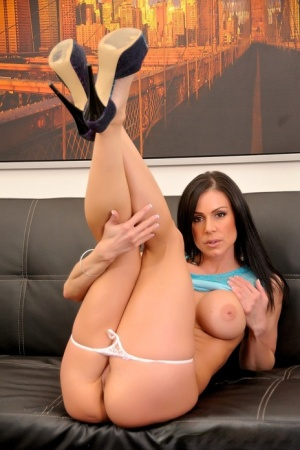 Dark haired female Kendra Lust does a striptease before fucking a big dick