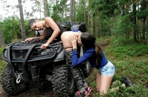 Brunette chicks take an ATV into the woods to explore lesbian sex