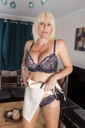 Sexy MILF Jan Burton removes her lace lingerie to bend over and spread pussy 95648053