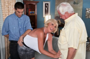 Hot granny Scarlet Andrews fucks a younger boy while her husband watches 23421663