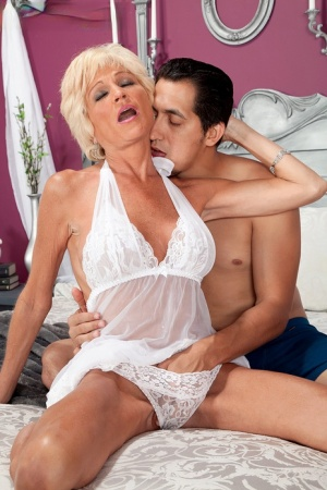 Horny mature woman rides on top of her younger Latino lovers cock