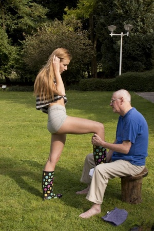 Skinny teen girl has sex with a really old man in rubber boots