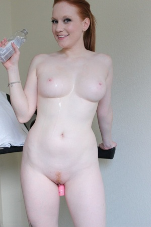 Fit redhead Lucy OHara pauses her workout to shove a dildo in her tight pussy 26429934