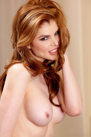 Redhead MILF Candle Boxxx tosses her dress aside to model in the nude