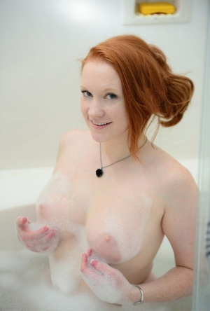 Pale redhead Lucy OHara lathering up her sweet perky tits  toes in the shower