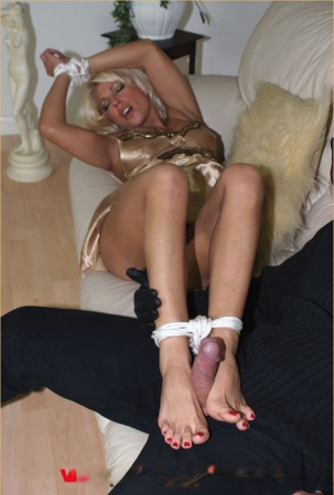 Blonde MILF Lana Cox has her bare feet tied and tickled by an intruder