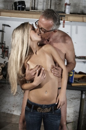 Young blonde Lucy gets banged by an old man over a vehicle at night