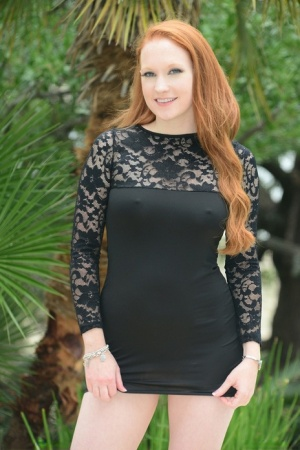 Redhead MILF Lucy OHara hikes her dress to ride Sybian like sex toy by pool 61387621