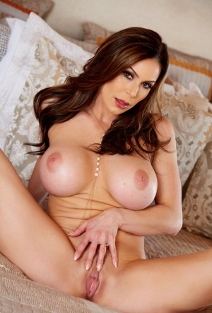 MILF model Kendra Lust unveils her big fake tits while removing her lingerie