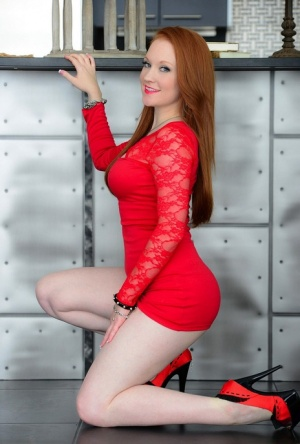Flaming hot redhead Lucy OHara lifts her slinky red dress to finger herself