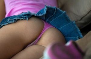 Young blonde girl Zoey Ryder flaunts her ass in a pink thong