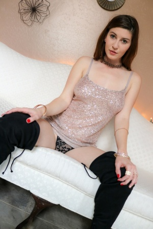 Solo girl Amber Hahn puts down the bubbly for nude selfies in OTK boots