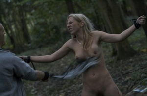 Busty hot blonde Caroline tied to a tree in the woods for naked ass whipping 80754277
