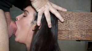 Brunette female Eden Sin learns to deepthroat while restrained on a Sybian