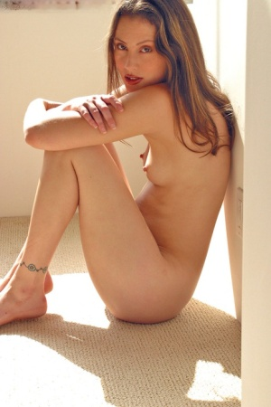 Naked small titted Jassie poses her hot slender body in bare feet on the floor 19125471