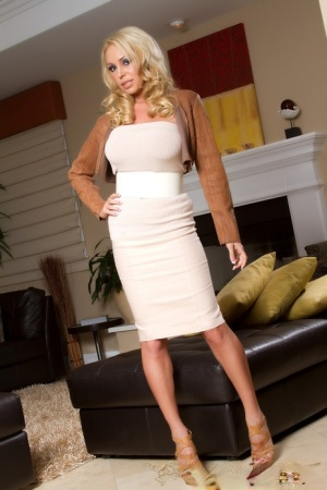 Busty blonde slut Mary Carey drops her white dress to flaunt huge beasts 24450305