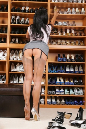 Leggy amateur Model Eve strips to lingerie and nylons in a shoe store