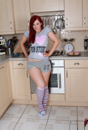 Sexy redhead Rosie Jaye drops her short in the kitchen to cook in the nude