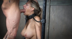 Busty sex slave Angel Allwood gets face fucked by a strapon lesbian and a man