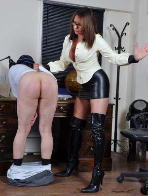 Older Domme Mistress Carly spanks mans bare ass in short skirt and long boots 50246114