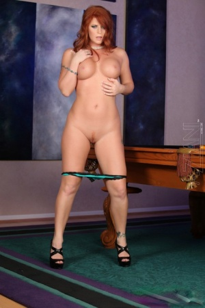 Busty ginger Sara Leona sheds her sexy short skirt to squat  toy her pussy