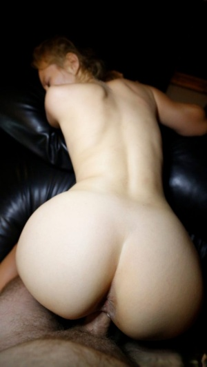 Blonde girl from Hungary strips naked on a leather chesterfield