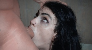 Dark haired tattooed slave Lydia Black with tiny tits gagged with big cock