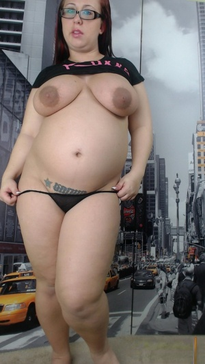 Pregnant hot redhead Peaches revealing her huge belly and massive nipples