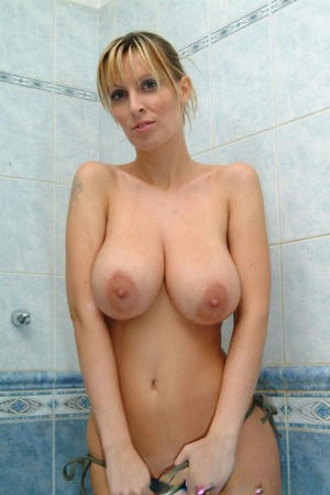 Busty bikini clad Milly Moris gets naked to fondle her big tits in the bath 38863409