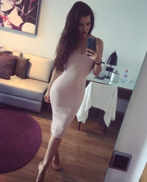 Beautiful dark haired Julia in skimpy outfits taking a sexy selfie