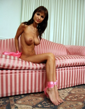 Skinny brunette with huge tits is cleave gagged and rope bound in the nude 56401307