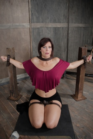Restrained female Syren De Mer pisses herself in the dungeon 59217317