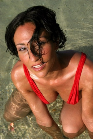 Sizzling brunette Lisa teases with amazing big tits in swimsuit at the beach
