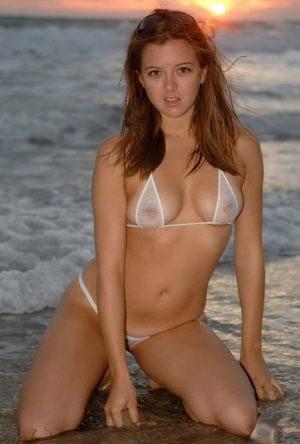 Brunette Becky LeSabre at the beach posing in the water in a sheer bikini 87024494