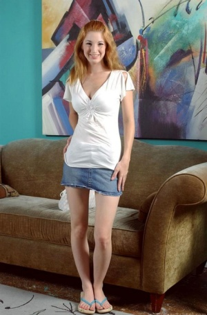 Sexy redhead Stephanie Wylde removes her jeans to sprad pussy for close up