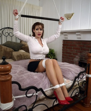 Clothed woman Alexis Taylor has her big tits exposed while tied up and gagged 97076367