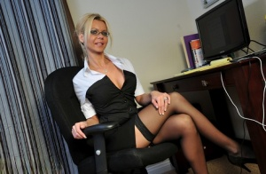 Blonde businesswoman Barbi Sinclair relieves pent up stress by masturbating 98737796