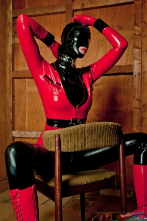Hot blonde models various items of latex clothing and footwear in solo action 21054058